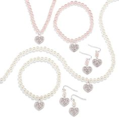 Pearlesque Heart 3-Piece Gift Set - A silvertone necklace, bracelet and earring set with faux pearls and rhinestone embellished heart charms. Offered in cream or Rose faux pearls. Regularly $19.99, buy Avon Jewelry online at http://eseagren.avonrepresentative.com