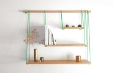 this is a specific product (from outofstock), but it would be cool to try to create something similar using bright rope & a dowel
