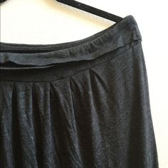 """Charcoal Maxi This gently used maxi skirt still has plenty of life left in it! It's fully lined, has some piling, and measures 36"""" long. There is a small patched hole in the front, but it's patched from the inside between the shell and lining, so you won't feel it and you won't see it. It's got an elastic waist so it could also work for an XL. Old Navy Skirts Maxi"""