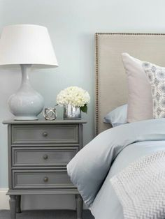 Love the color of the nightstand against the blue wall and neutral headboard.