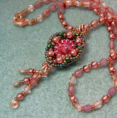 """""""Victoriana"""" is the name for this beaded pendant.  The rose-colored rivoli provides sparkle; the glass beads lend a feeling of yesteryear."""