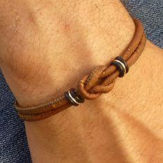 Mens unisex bracelet from Sirious Design's latest line of Eco friendly VEGAN jewelry! The best selling Celtic infinity Love Knot bracelet in natural brown. Great summer bracelet!