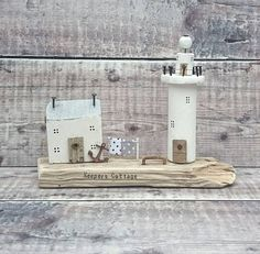 Check out this item in my Etsy shop https://www.etsy.com/uk/listing/522407370/wood-lighthouse-driftwood-house-keepers