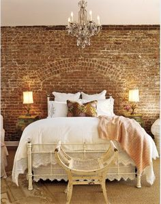 Love this. Love the bricks, contrasted with the classic white and the chandelier. SO stylish