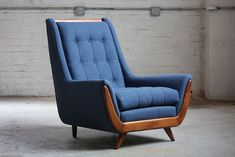 EyeCatching Mid Century Modern Lounge Chair (U S A is part of Living Room Interior Chairs - Denim blue dawgs! Beautiful wood elements with splayed front legs,