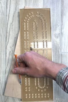 Learn how to make a DIY Cribbage Board out of scrap wood! The template makes it easy! Full tutorial on Reality Daydream! Scrap Wood Projects, Easy Woodworking Projects, Diy Projects To Try, Project Ideas, Craft Ideas, Cribbage Board Template, Diy Bottle Opener, Wood Crib, Michaels Craft