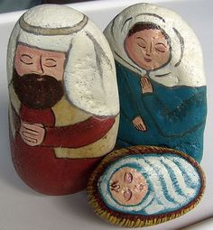 Nativity Set painted on rocks using rust red and ocean blue acrylic paint.