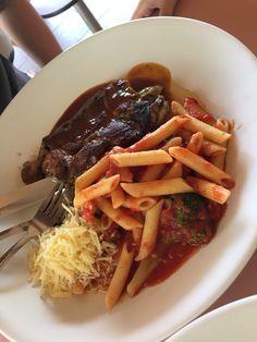 Grill chicken with tomato base spaghetti