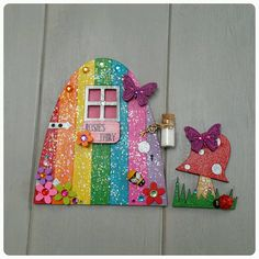 Welcome to the magical world of Doodle Dot Fairy and Elf Doors, our Doodle Dot Fairy Dotty is in charge of this section of the business, she designs all the doors and makes sure that they all reach their new homes ready for her Fairy friends to move in. Fairy/Elf doors can be given as gifts to children or adults! Just place the magical door above the skirting board or on a shelf in your little ones bedroom, their fairy/Elf will look out for them while they sleep. Our Rainbow doors are…