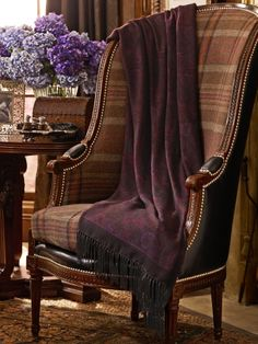 Plaid chair with a leather back, draped with a paisley throw -- Ralph Lauren