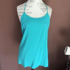 Teal blouse Tag says sleepwear, but I wore this once with linen Capris and it was really cute!!! Very breezy rayon top with strappy back. Xhilaration Tops