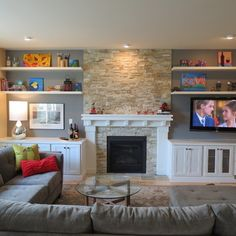 Living Room With Fireplace And Helves tv next to fireplace design ideas, pictures, remodel, and decor