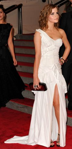 Who made Emma Watson's white one shoulder dress that she wore to the 2010 Met Costume Institute Gala on May 3, 2010?