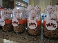Centerpiece - Bar Mitzvah (Maybe Mix the peanuts throughout in-between the baseballs w/ a baseball picture instead of the team logo)