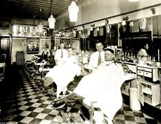 1940's - two barbers with their customers