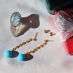 Holiday shopping decisions got us like, the Medusa Quartz ring or the Turquoise drop earrings? Shop gifts under $4000  Medusa Quartz ring and Yellow Sapphire and Turquoise earrings by Ricardo Basta Fine Jewelry - holiday gift ideas