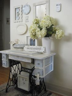 Decorating with Thrift Store Finds | added it to the wall display over my antique sewing machine as well.