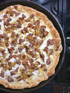 Experimenting with homemade pizza! White truffle oil and smoked Maldon on sausage vidalia onion roasted garlic and fresh mozzarella atop a garlic base.