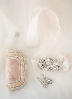 Bridal Accessories: Earrings & Sash from MariaElenaHeadpieces.com -- See the wedding here: http://www.StyleMePretty.com/2014/05/28/romantic-glamour-in-miami/ #SMP -   Photography: KTMerry.com