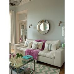 living rooms - Windsor Smith Home Riad - Mist Kenneth Wingard Atrium Mirror gray walls white lamps ivory blue imperial trellis lamp shades fuchsia throw white pillows gray ribbon trim ivory teal blue chevron zigzag rug mirrored coffee table found on Polyvore