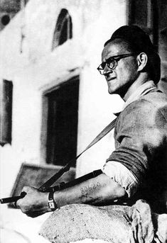 A Haganah soldier - with Auschwitz tattoo - doing sentry duty in Jaffa.