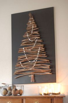 Looking for Christmas decoration for small space. Then you should definetly put up a wall Christmas Tree. Here are best DIY Wall Christmas tree ideas. Wooden Christmas Trees, Rustic Christmas, Christmas Home, Stick Christmas Tree, Christmas Tree Canvas, Christmas Stairs, Christmas Tree Painting, Holiday Tree, Christmas Projects
