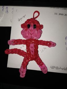 Monkey Charm This monkey is made from red and pink rainbow loom rubber bands.
