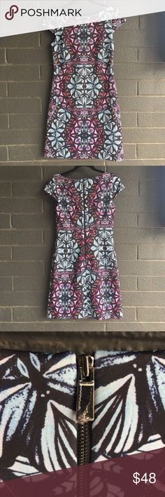 Vince Camuto Kaleidoscope Print Sheath Dress Trendy Vince Camuto kaleidoscope multicolor graphic print patterned sheath dress. Black with purple, blue, orange and pink print. Scuba material for fitted sheath look. 95% polyester, 5% spandex. In excellent, new without tags condition. The sticky preserving tap is still on the zipper. Vince Camuto Dresses