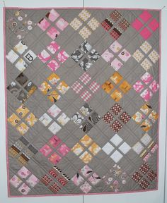 Daisy Baby quilt/ Free pattern uses 2 charm packs plus one other fabric