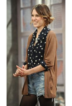 Alexa Chung with patterned blouse sleeves cuffed over cardigan at the elbow - Wish I'd seen this at the beginning of the winter season!