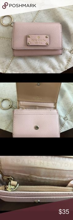 Kate Spade Keychain Mini Wallet This light pink leather mini wallet has a snap front closure, a back I.D. Compartment, an inside zipper coin center, 2 inside side pockets, & an inside I.D slit.  It's 4.5 inches across & 3.5 inches down.  Very gently used. . No stains. . Rips. . Marks!!! Kate Spade Bags Wallets