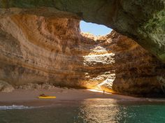 Algarve, PortugalAccessible by boat, this sea cave in the Algarve region of Portugal hides a secluded beach. The area around Benagil Beach is full of limestone formations, but this renowned cave is the region's trophy and every photographer's dream. Green Sand Beach, Sea Cave, Secluded Beach, Shell Beach, Beaches In The World, Island Beach, Algarve, World Heritage Sites, Beautiful Beaches