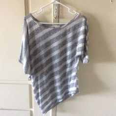 Silver-grey&light material asymmetrical shirt Silver-grey and grey shirt - Worn only a few times and in great condition! Really light material! Suzy Shier Tops Blouses