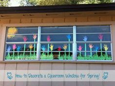 Image: window decoration deco spring classroom flower meadow flowers meadow with hands hand handprint as flower grass is made as well from hand prints Nese Cetin Classroom Door, Classroom Design, Classroom Displays, Preschool Classroom, Classroom Window Display, Window Displays, Decoration Creche, Spring Bulletin Boards, School Decorations