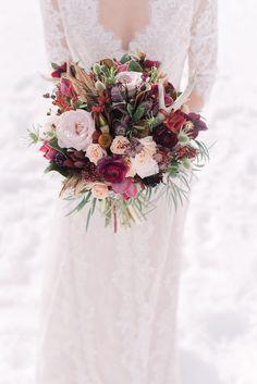 Winter boho wedding bouquet with antlers and feathers. By Willow Flower Co. | Photo by Darren Roberts Photography #bohemianwedding #lakelouise #winterwedding #marsala #weddingbouquet #rusticwedding