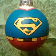Superman ornament. Hand painted. Cute idea. I may have to do this at a pottery shop, however this logo is incorrect, it's missing the red!