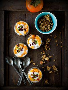 Persimmon Yogurt Granola Parfait // Crunchy granola, creamy and light yogurt with sweet fuyu persimmons… the bright colored fruits of fall.