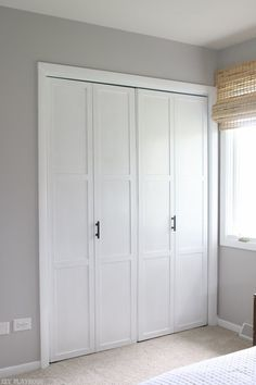 Have old bifold closet doors in your home? Upgrade them with this simple DIY tutorial. We added trim, paint, and sleek black handles for a new upgraded look on a budget!