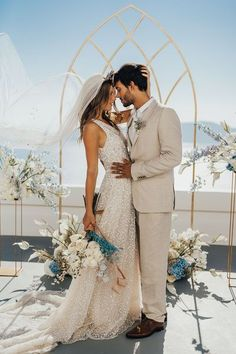 Romantic and intimate elopement photographs in Santorini | Modern and chic couple celebrating a sophisticated destination wedding | Outdoor ceremony with breathtaking views | Alena Leena sequin dress with halo crown tiara | Natural and soft bridal makeup and hair | Photography by Rebecca Carpenter, Planned & Styled by The Stars Inside #bride #groom #wedding #elopement #destinationwedding #santorini #adventureelopement #ceremony Pool Wedding, Elope Wedding, Chic Wedding, Wedding Ceremony, Elopement Wedding, Ceremony Arch, Outdoor Ceremony, Wedding Table, Wedding Venues