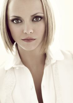 Christina Ricci is stunning with short blond hair.