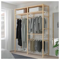 IKEA - IVAR, Shelving unit with clothes rail, Untreated solid wood is a durable natural material which is even more hardwearing and easy to look after if you oil or wax the surface. You can move shelves and adapt spacing to suit your needs. Clothes Rail Ikea, Clothes Shelves, Ikea Shelving Unit, Metal Shelving Units, Ikea Ivar Regal, Garderobe Design, Ikea New, Simple Wardrobe, Diy Furniture