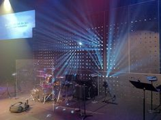 Beaming | Church Stage Design Ideas... Metal sheet with lighting behind it.. simple, but cool :0