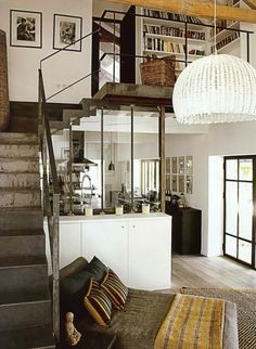 love the industrial elements of this apartment. the rough metal stairs, the stainless elements in the kitchen