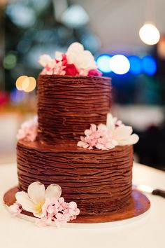 chocolate wedding cake - photo by Debbie Lourens Photography http://ruffledblog.com/summer-destination-wedding-in-cape-town