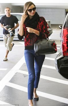 October 27, 2014: Keeping mum: Miranda Kerr wasn't giving anything away when she stepped out for a spot of s...
