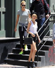 Workout buddies: Karlie and Taylor resemble each other being both all-American blonde Amazons who measure 6ft1in and 5ft10in, respectively