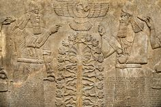 Assyrian relief sculpture panel of King Ashurnasirpal II dressed in Ritual robes, he is depicted twice on either side of the central sacred tree of life. Above the tree of life is a winged disc with possible the sun god Shamash in it. From Nimrud, Iraq