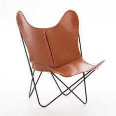 AIRBORNE DESIGN, Buffalo Chair, fauteuil AA Structure inox marin noir, Housse cuir buffle fauve. 78 X l69