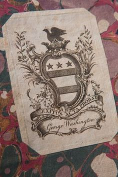George Washington Family Coat-of-Arms appears as a bookplate in one of his books. A bookplate is a decorative label put in the front of a book which bears the name of the book's owner.