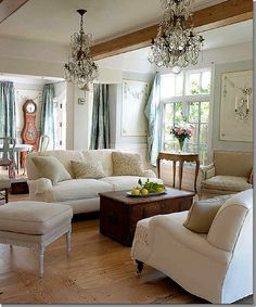 Neutral couch arrangement in small space, cozy but not crowded.  Chandeliers to die for... Love curtains - silk?